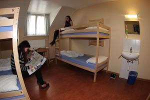 A bunk bed or bunk beds in a room at Bern Backpackers Hotel Glocke