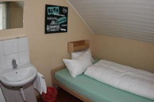 A bed or beds in a room at Bern Backpackers Hotel Glocke