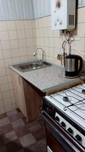 A kitchen or kitchenette at Guest House Tengiz