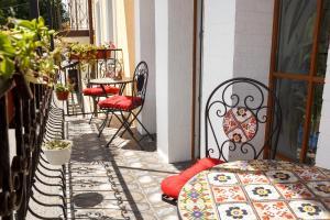 A balcony or terrace at Art house Hostel
