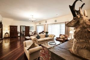 A seating area at Safari Park Hotel