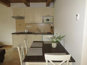 Kuchyň nebo kuchyňský kout v ubytování Apartmán Javorník a Javorníček
