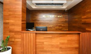 The lobby or reception area at Treebo Trend Durga Bhoji Grand,Coorg