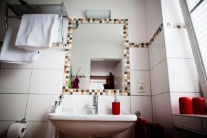 Ein Badezimmer in der Unterkunft An der Rauschen - Apartments, Ferienzimmer & Kunst