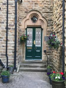 The facade or entrance of Farnley Tower Guesthouse