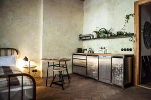 Kuchyň nebo kuchyňský kout v ubytování The Emerald