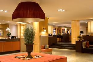 De lobby of receptie bij Starhotels Metropole