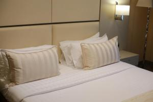 A bed or beds in a room at Port Palace
