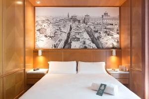 A bed or beds in a room at B&B Hotel Modena