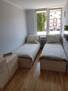Łóżko lub łóżka w pokoju w obiekcie Apartament Przymorze