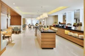 A restaurant or other place to eat at Fairfield by Marriott Chennai OMR