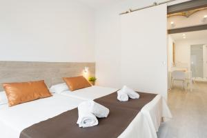 Cama o camas de una habitación en BcnStop Sagrada Familia