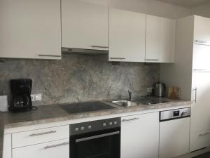 Küche/Küchenzeile in der Unterkunft Ferienwohnung Kopp