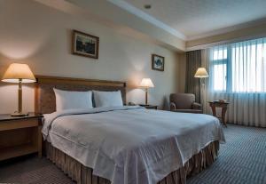 卡爾登飯店中華館房間的床