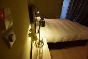 Ένα ή περισσότερα κρεβάτια σε δωμάτιο στο Arahova Pansion