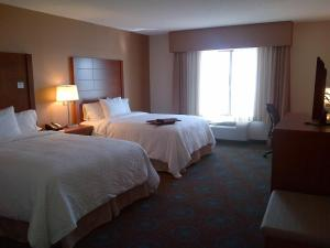 A bed or beds in a room at Hampton Inn by Hilton Brampton - Toronto