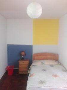 A bed or beds in a room at Hostal Isidoros