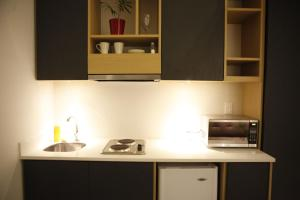 A kitchen or kitchenette at The Grace Hotel