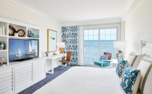 A television and/or entertainment center at Isla Bella Beach Resort & Spa - Florida Keys