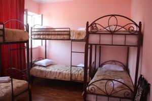 A bunk bed or bunk beds in a room at Dream Hostel Shymkent