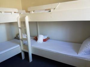 A bunk bed or bunk beds in a room at El Lago Tourist Park
