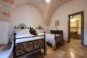 Letto o letti in una camera di Masseria Lamiola Piccola