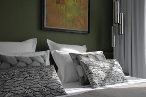Postel nebo postele na pokoji v ubytování The Sleeping Lion