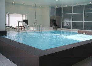 The swimming pool at or near Hotel Royal Astrid