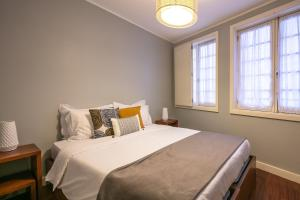 A bed or beds in a room at Stay In Apartments