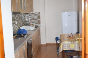 A kitchen or kitchenette at Freddie' s House