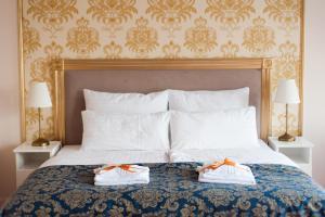 Łóżko lub łóżka w pokoju w obiekcie Folwark Ńemino
