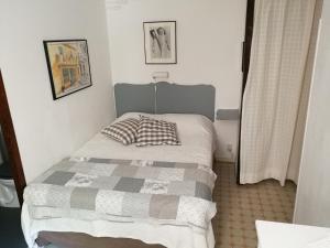 Säng eller sängar i ett rum på Villa Asmodée