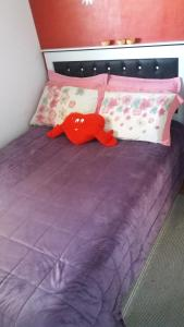A bed or beds in a room at Re Vieira bloco do urso