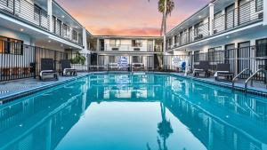 The swimming pool at or near Sunset West Hotel, SureStay Collection By Best Western