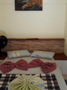 Cama ou camas em um quarto em Pousada do Horto