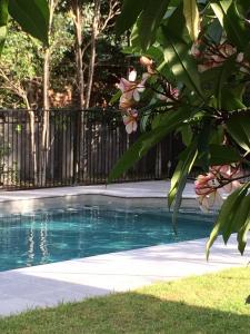 The swimming pool at or near Arabella Garden Inn