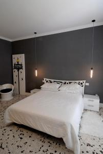 A bed or beds in a room at B&B Tiburtina Garden