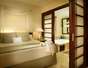 A bed or beds in a room at The Reserve at Paradisus Punta Cana - All Inclusive