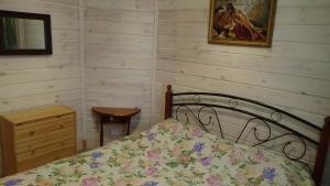 Кровать или кровати в номере Dom v Abzakovo