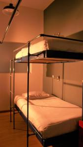 A bunk bed or bunk beds in a room at Hobu Hostel