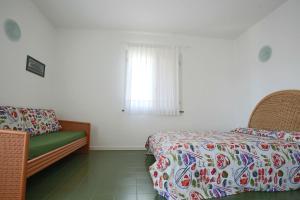 Postel nebo postele na pokoji v ubytování Residence Selenis