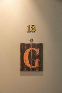 Ein Zertifikat, Auszeichnung, Logo oder anderes Dokument, das in der Unterkunft Inspirational Apartment ausgestellt ist