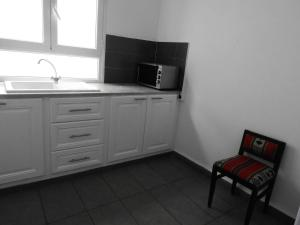 A kitchen or kitchenette at Appartement Dar Sébastian- Hammamet