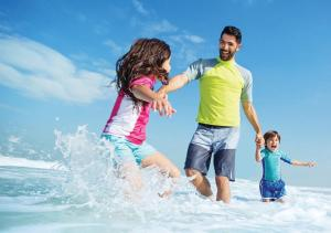 A family staying at Jumeirah Messilah Beach Hotel & Spa Kuwait