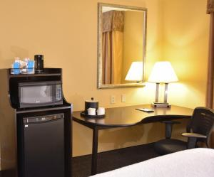 A television and/or entertainment center at Hampton Inn & Suites Alexandria