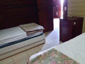 Cama ou camas em um quarto em Pousada Cultural Canto dos Poetas