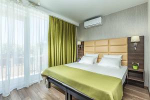 Кровать или кровати в номере Бутик отель Ла Мелия