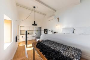 A bed or beds in a room at Sapientia Boutique Hotel