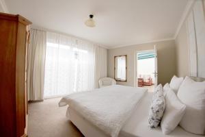 Ein Bett oder Betten in einem Zimmer der Unterkunft Appartementhaus Sonnengarten