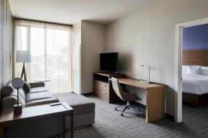 A television and/or entertainment center at Residence Inn By Marriott Dallas By The Galleria